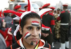 An Egyptian wears face paint in the colors of the national flag during celebrations Saturday in Cairo's Tahrir Square, the epicentre of the popular revolt that drove veteran strongman Hosni Mubarak from poweR.