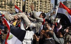 Egyptians dance Saturday in Cairo's Tahrir Square. Protesters celebrated after Hosni Mubarak resigned as president on Friday.