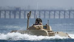 In this Aug. 24, 2010, file photo, a prototype of a Marine Expeditionary Fighting Vehicle runs a test in the waters off the coast of Oceanside, Calif.