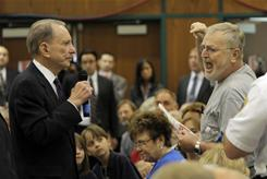 A man complains to then-senator Arlen Specter, D-Pa., at a town hall meeting Aug. 11, 2009, in Lebanon, Pa.