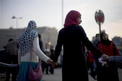 Protesters hold hands in Tahrir Square in Cairo Feb. 12.