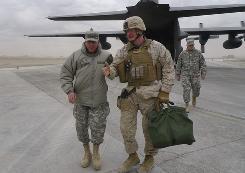 Marine Maj. Gen. Richard Mills, right, talks with Gen. David Petraeus, NATO's top commander in Afghanistan, on Jan. 10.