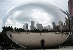 "Chicago, reflected in the ""Cloud Gate"" sculpture at Millennium Park, is likely to remain the nation's third largest city, even though it lost 7% of its residents in the last decade, according to Census data."