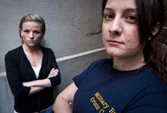 Veterans Kori Cioca, 25, of Wilmington, Ohio, left, and Panayiota Bertzikis, 29, of Somerville, Mass.,who say they were assaulted and raped while serving in the U.S. Coast Guard, meet at their attorney's office in Washington.