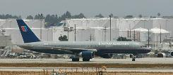 A United Airlines Boeing 757 jet taxis at Los Angeles International Airport in 2008.