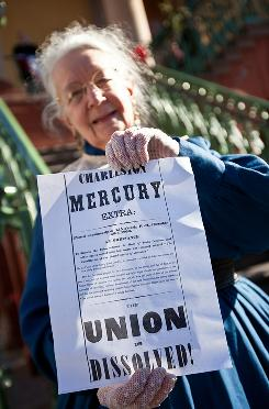 June Murray Wells, director of the Confederate Museum, holds a copy of South Carolina's secession ordinance.