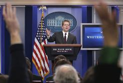 Press secretary Jay Carney addresses questions Wednesday during his first White House briefing.
