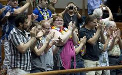 Hawaii residents applaud the state Senate's approval of a civil unions bill Wednesday in Honolulu.