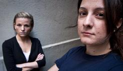 Veterans Kori Cioca, 25, of Wilmington, Ohio, left, and Panayiota Bertzikis, 29, of Somerville, Mass., both assaulted and raped while serving in the U.S. Coast Guard, meet at their attorney's office in Washington on Feb. 13, 2011.
