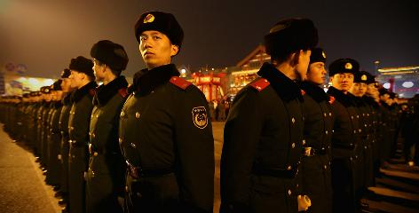 Paramilitary policemen keep order Thursday during the Lantern Festival on the last day of Chinese Lunar New Year celebrations in Beijing.