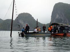 Rescuers search for victims of a sunken tourist boat on Ha Long Bay in northern Quang Ninh province.