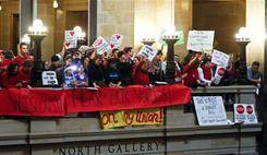 Teachers and others protest at the Capitol building in Madison, Wis., against Gov. Scott Walker's bill to eliminate collective bargaining rights for many state workers.