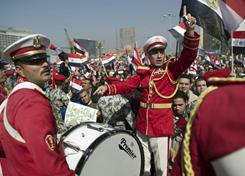 An Egyptian army band plays music in Cairo's Tahrir Square on Friday during celebrations marking one week after Egypt's long-time president Hosni Mubarak was forced out of office.