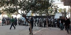 Young protesters clash with riot police on Sunday in Annaba, Algeria.