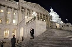 Congressmen walk down the steps of the House of Representatives as they work overnight Friday on a spending bill.