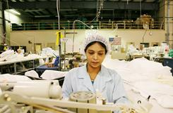 Ah Sar Bi, 37, sews coverings for Butterworth Enterprises, a family-owned company in Gas City, Ind.