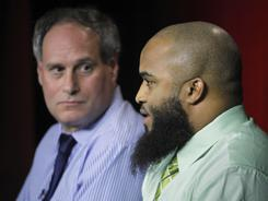Abdullah al-Kidd, right, and attorney Lee Gelernt talk about his case against former attorney general John Ashcroft.