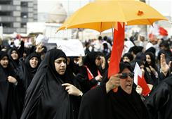 Bahraini anti-government protesters chant slogans during a demonstration at Pearl Square in Manama on Monday.