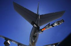 A U.S. Air Force KC-135 Stratotanker tanker from the 19th Refueling Group at Robins AFB, Georgia, lowers it's refueling boom to a B-52 bomber.
