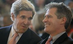 Sen. Scott Brown, R-Mass., right, sits with Sen. John Kerry, D-Mass., at the induction ceremony of U.S. District Judge Denise Jefferson Casper on Friday in Boston.