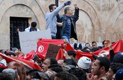Tunisian protesters in the capital on Monday demanded that the caretaker government resign.