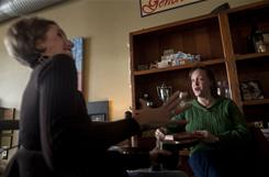 Jenna Theissen, right, and Jodi Cincotta discuss the turmoil in Madison over the budget at The Coffee Vault in Dousman, Wis., on Wednesday.