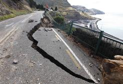 Part of a road was damaged by Tuesday's earthquake on the outskirts of Christchurch, New Zealand.