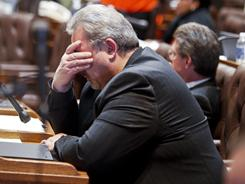 Rep. Mark Honadel, R-South Milwaukee, rubs his eyes during the 23rd hour of debate in the Assembly at the state Capitol in Madison, Wis., early Wednesday morning.