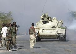 Somali government soldiers take positions during clashes with Islamist insurgents in southern Mogadishu's Daynile neighborhood on Wednesday.