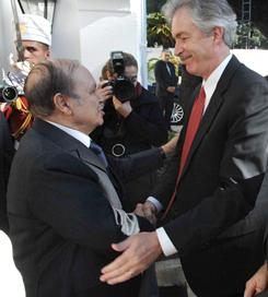U.S. Under Secretary of State for Political Affairs William J. Burns, right, is greeted by Algeria's President Abdelaziz Bouteflika, left, before meeting at the Djenan-El-Mufti residence in Algeria on Thursday.