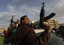 A protester holds a rifle as he shouts slogans against Libyan Leader Moammar Gadhafi during a demonstration in Tobruk, Libya, on Wednesday.