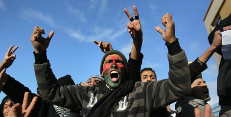 Protesters demand Libyan leader Moammar Gadhafi's removal in Benghazi.
