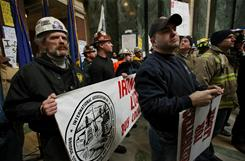 Members of the Iron Workers and firefighters unions demonstrate in the rotunda of the state Capitol in Madison, Wis., on Thursday.