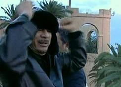 Libyan leader Moammar Gadhafi encourages his supporters Friday at the Green Square in the capital.