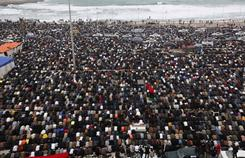 Protesters offer their Friday prayers as they gather to protest against Libyan leader Moammar Gadhafi in Benghazi, Libya.