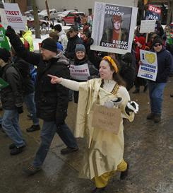 People participate in Saturday's demonstration in front of the state Capitol in Madison, Wis.
