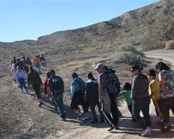 Families hike in Moapa Valley National Wildlife Refuge during a Jan. 29 trip organized by the Children's Heart Center.