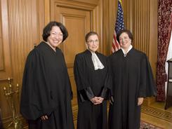 Justices Sonia Sotomayor, Ruth Bader Ginsburg and Elena Kagan await Kagan's Investiture Ceremony at the court on Oct. 1.