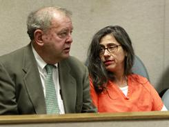 Nancy Garrido talks with her attorney, Stephen Tapson, before the start of a hearing in Placerville, Calif., on Monday.
