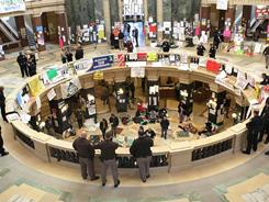 Police watch over the group of protesters that remained in the Wisconsin Capitol rotunda on Monday.