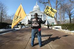 Rich Yaeger protests Monday at the Capitol in Madison, Wis. Protesters remained inside on the eve of Gov. Walker's budget address.