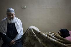 The father of Mohamed Attia, arrested in 1993 at age 18, sits by his wife, who has a kidney ailment.