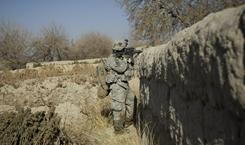 An Army corporal patrols on Dec. 21 in Kandahar, Afghanistan. Army units in that country will get devices to detect hidden shooters.
