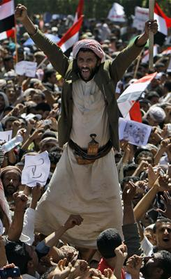 An anti-government protester shouts slogans during a demonstration demanding the resignation of Yemeni President Ali Abdullah Saleh in Sanaa.