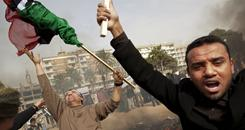 "Copies of Libyan leader Moammar Gadhafi's ""Green Book"" are burned during a demonstration Wednesday in Benghazi, Libya."
