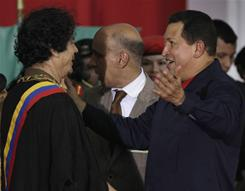 Libya's President Moammar Gadhafi, left, is congratulated by Venezuela's President Hugo Chavez after being decorated with the Simon Bolivar Order in Porlamar, Venezuela, in September 2009.