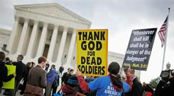 Jacob Phelps, grandson of Westboro Baptist Church pastor Fred Phelps, demonstrates on Oct. 6 outside the Supreme Court.