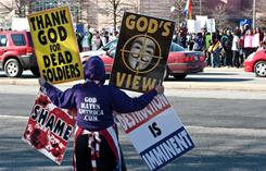 A member of Westboro Baptist Church, which is known for its vehement anti-gay stance and for protesting at funerals of U.S. troops, demonstrates outside a Maryland school March 1.