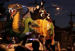 Members of the Krewe of Ancient Druids throw beads Wednesday in New Orleans.