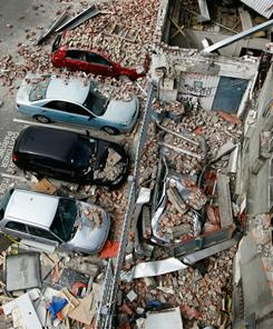 Damaged vehicles and debris are seen in the central business district Wednesday  in Christchurch, New Zealand.